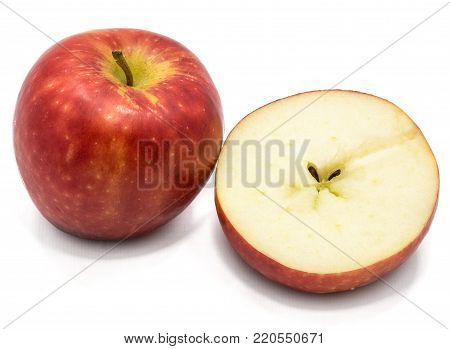 One whole Kanzi apple, one cross section half, isolated on white backgound