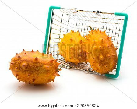 Three kiwano fell out a shopping basket isolated on white background