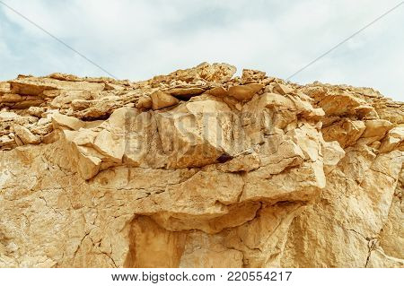 View on desert mountain and sky near the dead sea in Israel. Infinity valley panorama of lone sand, rocks, hills and stones. Waterless middle east territory, silence and heat.