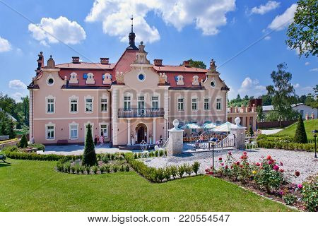 CZECH REPUBLIC, KUNICE - JUN 15, 2015: castle Berchtold from 1877 and park with model miniatures of czech landmarks, Benice, Vidovice village, Czech republic.