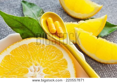 medicine and health care - orange and vitamin C
