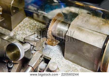 Close view of key copying machine with keys in locksmith workshop