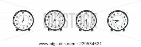 Closeup group of black and white clock for decoration show the time in 7 , 7:15 , 7:30 , 7:45 a.m. isolated on white background