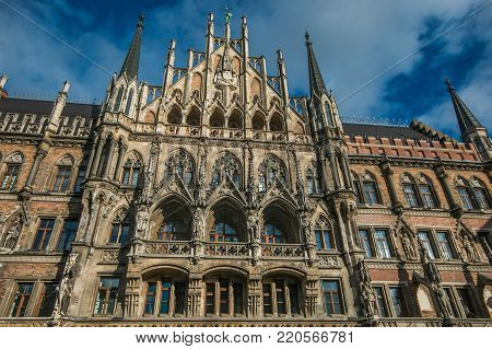 View of the main facade of the New Town Hall (Neues Rathaus) building by Georg von Hauberrisser at the northern part of Marienplatz in Munich, Bavaria, Germany