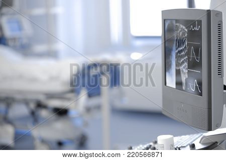 Medical test results depicted on the computer monitor in the patient's ward