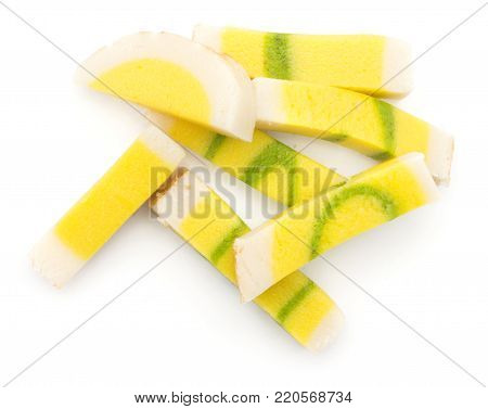 Marzipan stack isolated on white background pineapple citron taste yellow green pieces
