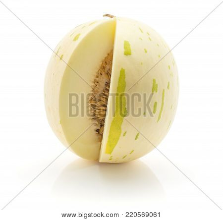 Sliced melon (Piel de Sapo, Honeydew) isolated on white background one cut open with seeds