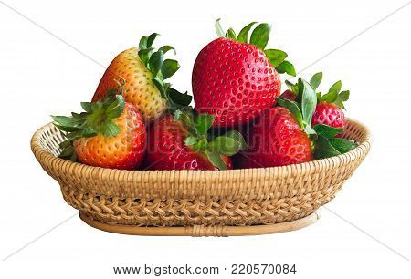 Ripe strawberry in rustic wood basket. Fresh strawberry on white isolated background with clipping paths. Prepare fresh strawberries for salad cooking. High vitamin and healthy fruits concept. Red strawberry with clipping paths.