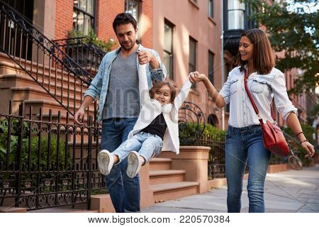 Family taking a walk down the street