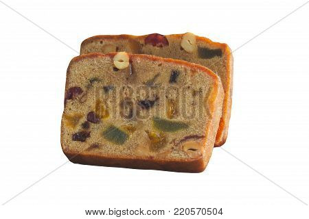Homemade rum fruit cake sliced to pieces. Delicious rich rum fruit cake on white isolated background with clipping paths. Traditional classic fruit cake or dessert for Christmas celebration so delicious soft and moist. Fruit cake with clipping paths.