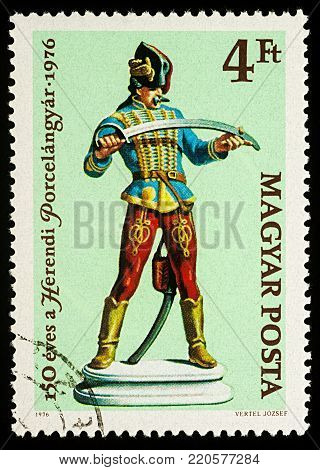 Moscow, Russia - January 02, 2018: A stamp printed in Hungary, shows Porcelain figurine of a hussar, series