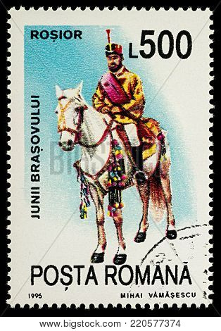 Moscow, Russia - January 04, 2018: A stamp printed in Romania, shows celebrating man riding on a horse, Rosior, series