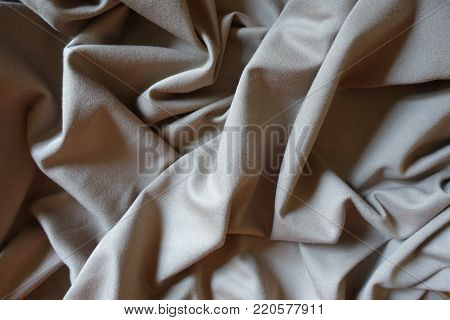 Draped simple beige viscose and polyester fabric