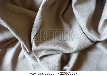 Folded simple beige viscose and polyester fabric