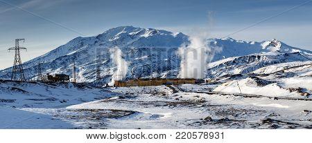 MUTNOVSKY VOLCANO, KAMCHATKA PENINSULA, RUSSIA - OCT 22, 2017: Winter panorama on Mutnovskaya Geothermal Power Plant (Mutnovskaya GeoPP-1) Geotherm JSC (RusHydro) at foot of volcano Mutovskaya Sopka.