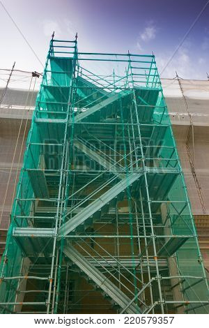 Scaffolding with protection to work on the facade