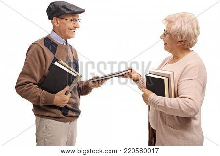 Elderly man and an elderly woman exchanging books isolated on white background