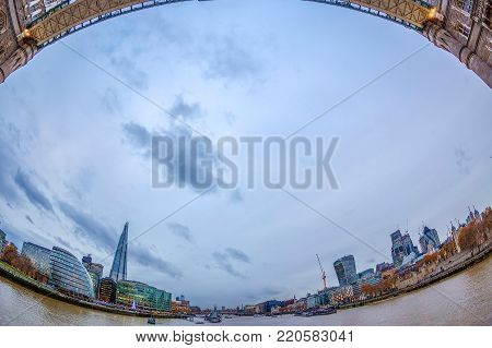 LONDON, ENGLAND - NOVEMBER 27, 2017: Fish Eye view architecture from Tower Bridge and London over river Thames with skyscrapers.