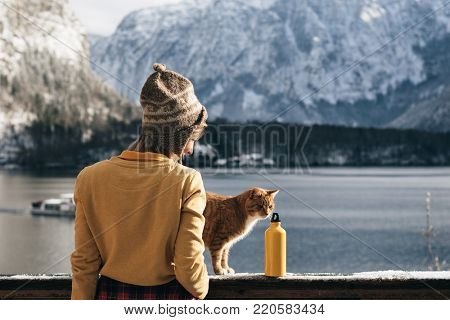 Woman with her cat at balcony. Beautiful view from balcony.