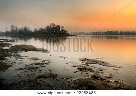 Picturesque landscapes of sunset over the river. Majestic landscape. Vistula river, Poland, Europe. Beauty world. Autumn landscape. Sunset over the river.
