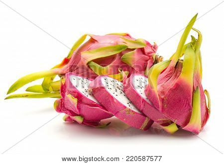 Sliced dragon fruit (Pitaya, Pitahaya) isolated on white background one whole and one sliced in four pieces