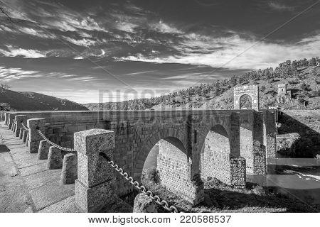View of the Roman bridge of Alcantara in Cáceres, Extremadura. Spain