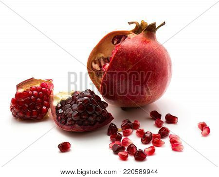 Open pomegranate with grains isolated on white background poster