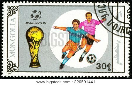 Ukraine - circa 2018: A postage stamp printed in Mongolia shows drawing Football duel. Italia 90. Series: World Cup Football. Circa 1990.