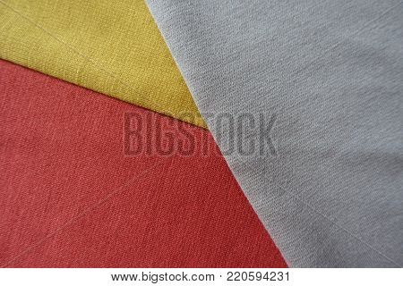 Coral red, yellow and beige fabrics sewn together