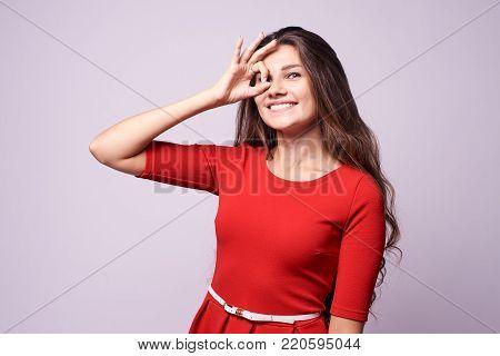 Beautiful girl. Gesture consent. White background. Portrait brunette.