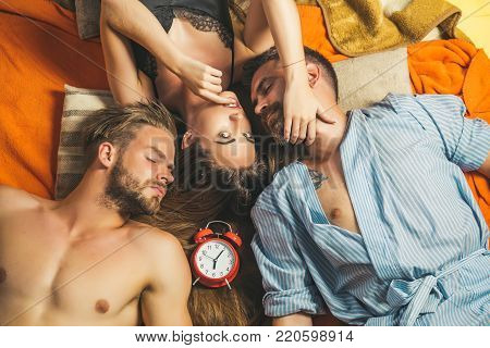 Love triangle and romance, perfect morning. Swinger relations, relax, wake up. Family trust, polygamy, betrayal. men and woman with long hair, lover. people lovers sleep at alarm clock, time. friends