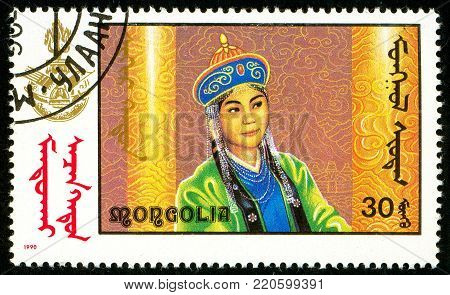 Ukraine - circa 2018: A postage stamp printed in Mongolia shows drawing a woman in Mongolian national clothes. Circa 1990.