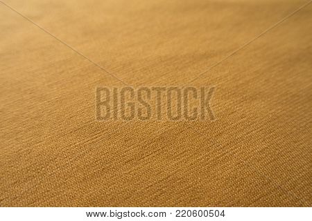 Close view of  amber yellow jersey fabric