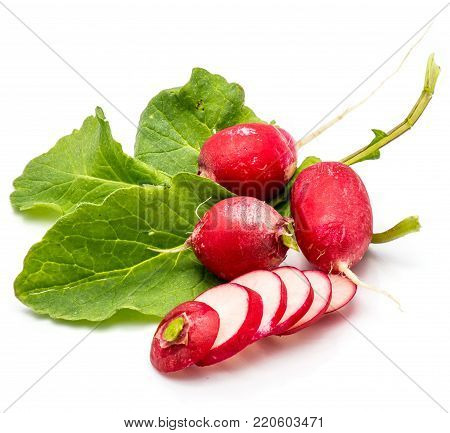 Three bulbs of red radish on fresh green leaves, sliced round circles, isolated on white background