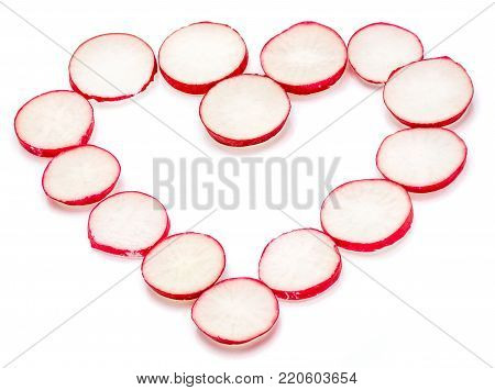 Sliced red radish in form of heart isolated on white background