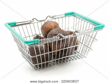 Salak in a shopping basket isolated on white background