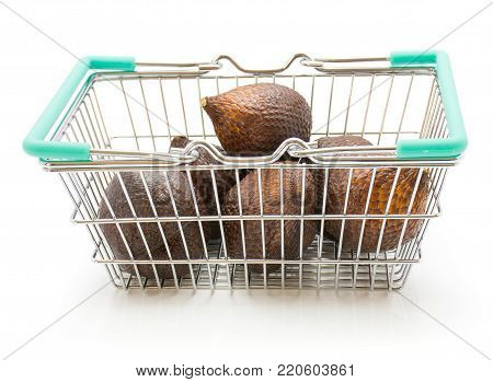 Snake fruit in a shopping basket isolated on white background