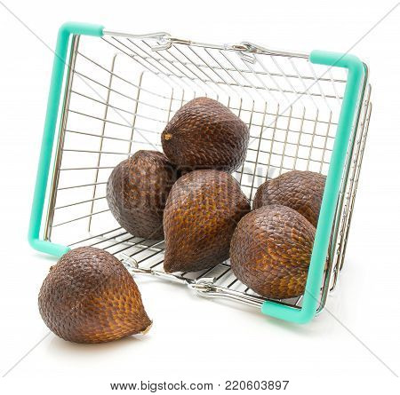 Salak out of a shopping basket isolated on white background