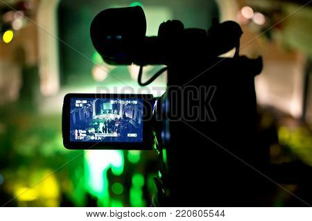 Filming a video recording on a cultural event.