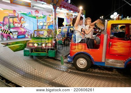 Montagnana, Italy - July 14, 2017: A Child Is Riding In An Amusement Park.