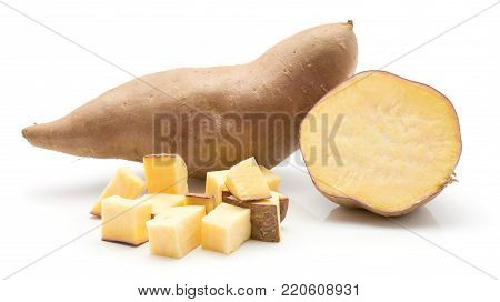 Sweet potato isolated on white background one whole one sliced half and chopped pieces
