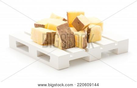 Chopped sweet potato pieces on pallet isolated on white background