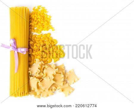 Spaghetti and three kinds of pasta on white background, isolated. The view from the top.