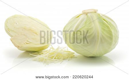 Chopped white cabbage and one whole head with one half isolated on white background