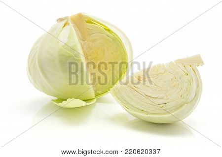 Open white cabbage head with a quarter isolated on white background