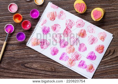 Congratulatory Background On Valentine's Day And Acrylic Paints, A Potato Heart Stamp On A Wooden Ta