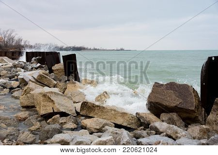 Lake Water Hitting The Rocks On A Cold Winter Day