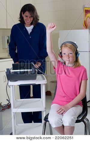 School Nurse Giving Hearing Test