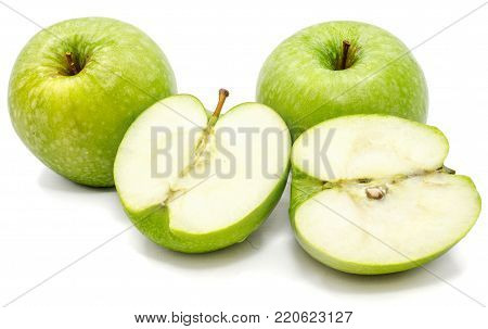 Halved apple Granny Smith, two whole and two halves, isolated on white background
