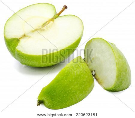 Sliced apple Granny Smith, two slices and one half, isolated on white background